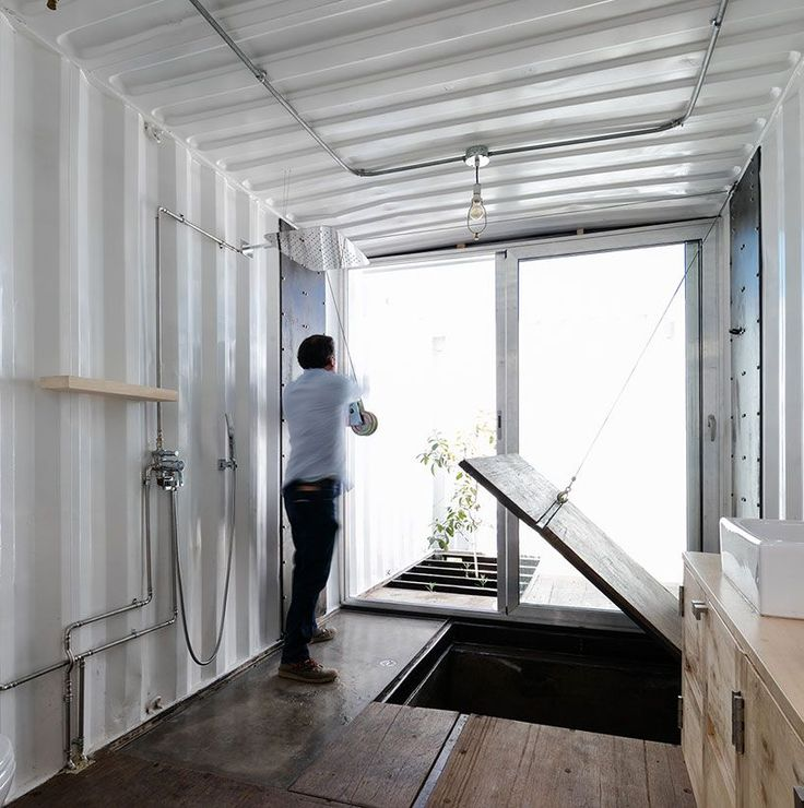 8 shipping containers combine to create surprisingly - Shipping container public bathroom ...