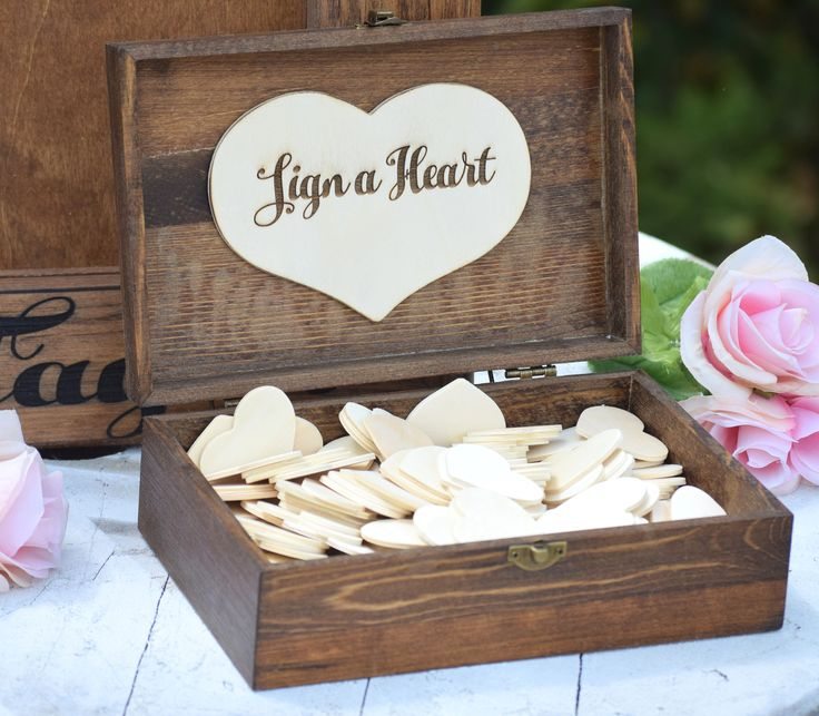 "This adorable box is the perfect addition to hold your guest note hearts! Inside hearts reads, ""Sign a Heart"" but can be customized to read whatever you would like. Additional fonts and stain options"