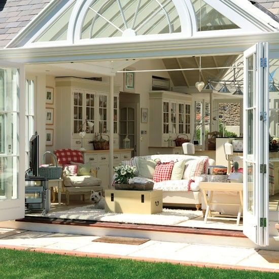 Dream come true: family room/sun room that opens onto the garden. Love this...Great solarium with cross ventilation!