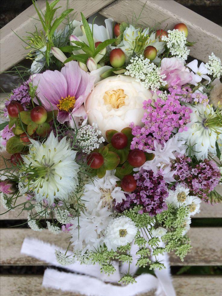 Bridesmaids bouquet with seasonal roses, cosmos, nigella, achillea, hypericum, marjoram, ammi majus