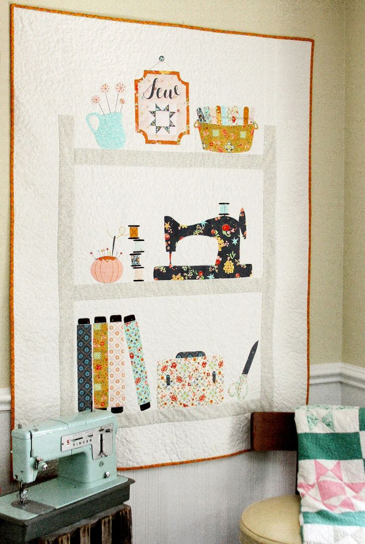 This sweet Sewing Shelves Applique Quilt is the perfect addition to your sewing studio, or as a gift for your favorite seamstress.
