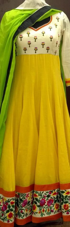 Lime yellow anrakali with white yolk and colourful floral border. Freen dupatta with grey-black border.
