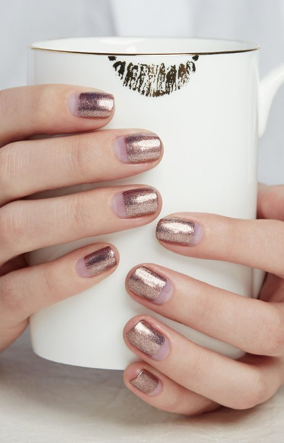 If your style in feminine and flirty and you love all things pink and lacy (even in the colder months), a shiny pink manicure for the holidays is the way to go. | A Metallic Manicure for Every Holiday Party