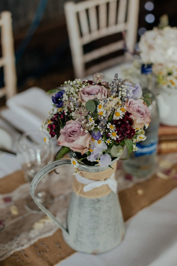 Pitcher jug Filled with Wild Flowers | Townfield Barn Wedding Venue | Vintage Tea Theme | Maggie Sottero Lace Gown | Tweed Suits | Wild Flowers | Antique Books | Mike & Tom Photography | http://www.rockmywedding.co.uk/charlotte-toby/