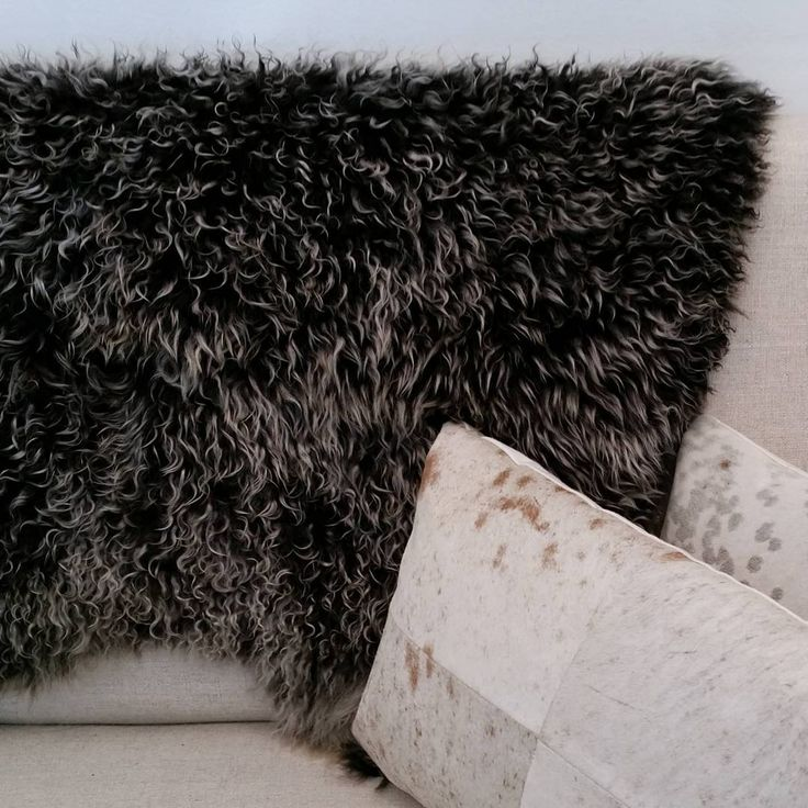 """Angora goat throw couple with cowhide cushions to relax on this long weekend: """"Happy Labour Day!"""" @martine_gallery #cowskin #cushion #fur #cowhide #throw #interiorstyling # homedecor #stylish #luxuryinterior # Angora #goatskin @ handcrafted"""