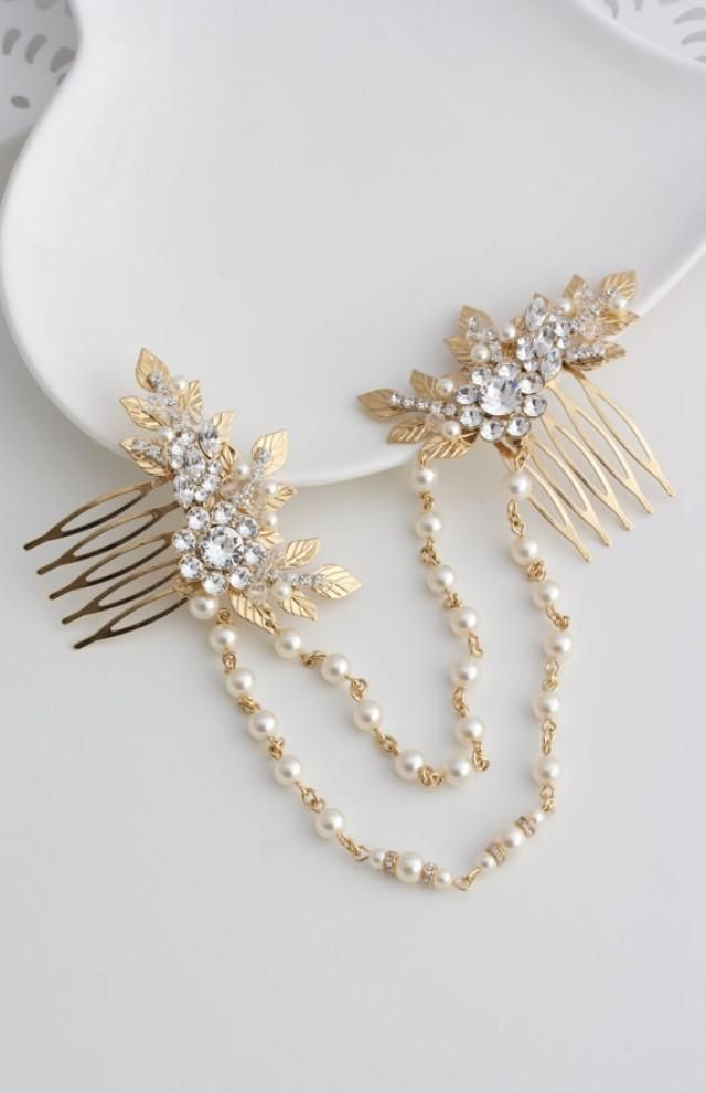 A Unique and eye catching Gold Wedding Headpiece! Handmade featuring lovely vintage leaves and settings accented with Swarovski crystal and Pearl,