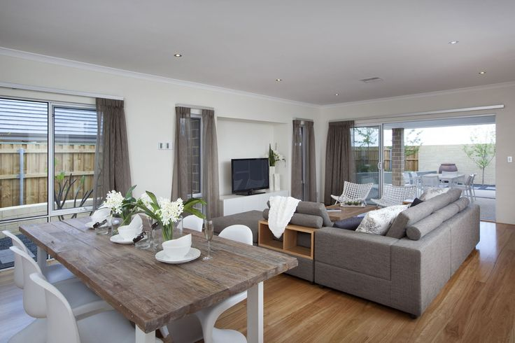 Love the lounge, white window frames and floorboards!