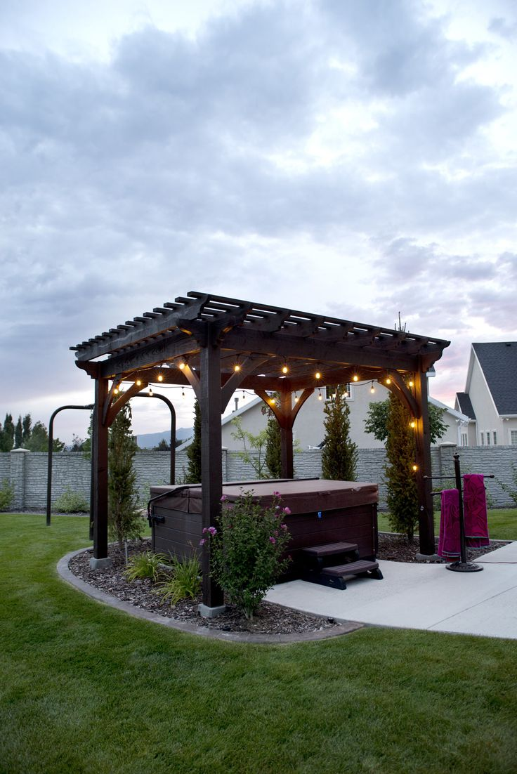 Timber Frame ShadeScape™ DIY Pergola Kit From Western Timber Frame  Installed Over Backyard Hot Tub With Outdoor Lighting.