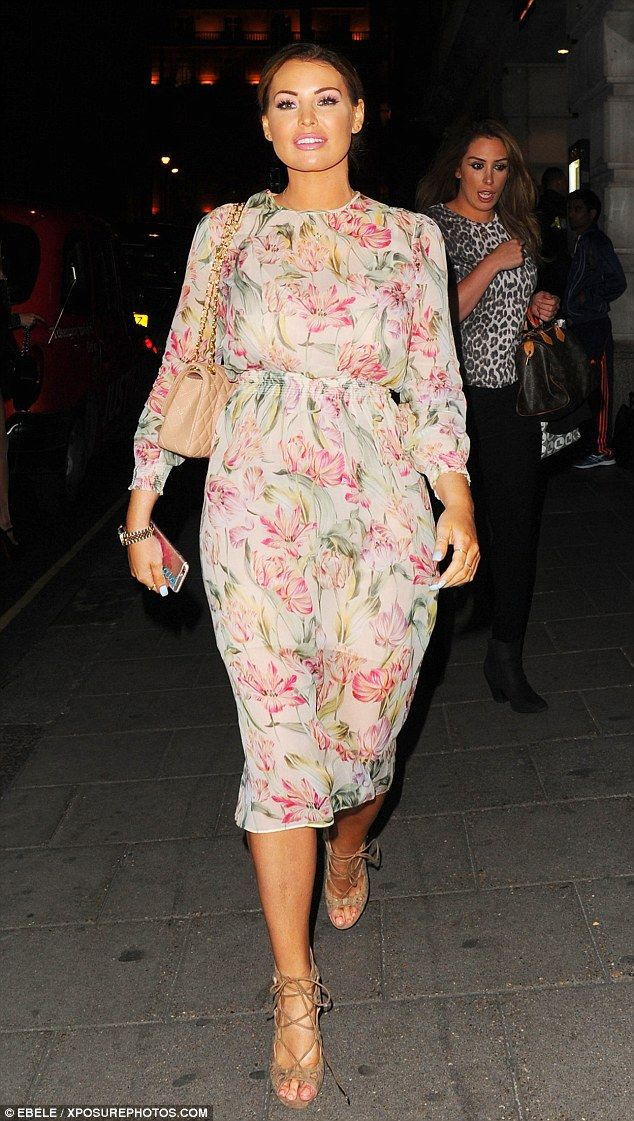 Pretty as a petal! She's never been shy of showing off her famous figure. But Jessica Wright opted to conceal her curves for a night out at Nobu restaurant in London on Friday