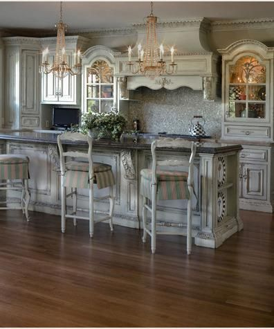 This definitely appeals to the whole shabby chic / French country kitchen thing I love.  Love it!