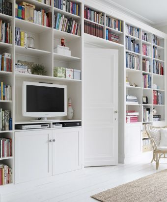 Floor-to-ceiling customised bookshelves completed with unfinished IKEA cabinet doors | Yvonne's dream home in Belgium #IKEAFAMILYMAGAZINE