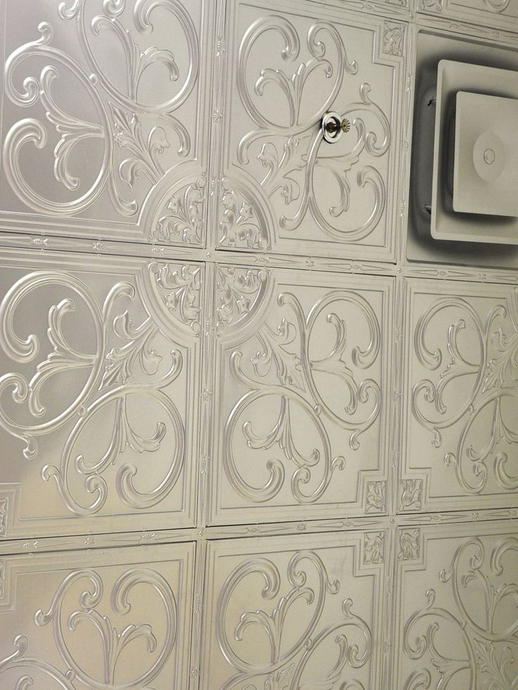 """DIY, Drop In and Glue Up, Plastic Faux Tin Ceiling Tiles model: #204 Silver Size: 24"""" x 24"""", Installation type: Glue Upand Drop In. Price: 10.49 USD. Trimmed by G1-Peel & Stick Cover Strips, 24 pcs in a pack.  Size: 23 3/4"""" x 1"""", Price: 25.00 USD (per 1 pack). Talissa Decor: http://www.talissadecor.com/catalog/glue-up-faux-tin-ceiling-tiles/metallic-ceiling-tiles"""