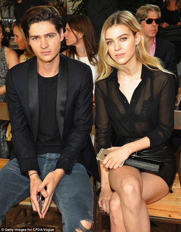 Smiling on the inside: Actors Will Peltz and Nicola Peltz set a serious tone on the front row