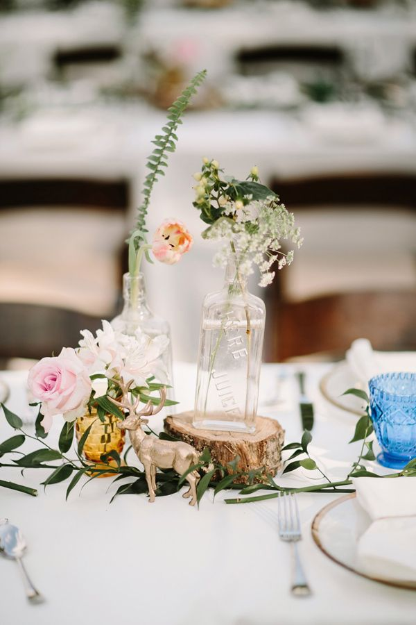 relaxed and eclectic centerpiece, photo by Q Avenue Photo http://ruffledblog.com/adventurous-historic-cedarwood-wedding #weddingideas #centerpieces