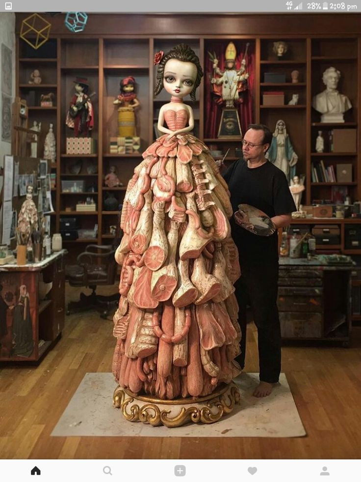 Mark Ryden working on his polychrome carved wood sculpture