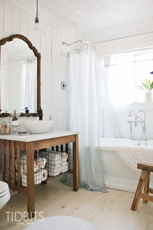 Cottage bathroom renovation - love the vanity and free standing tub eclecticallyvintage.com