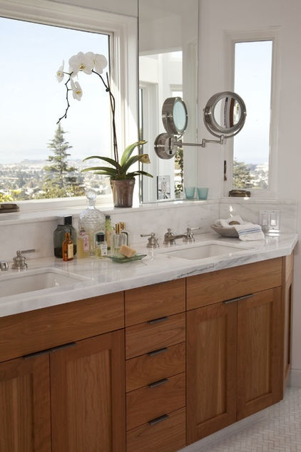 Double sink under the window with pull out mirrors.