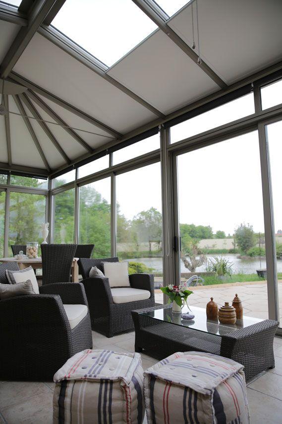 Véranda Concept Alu gamme ARMONIA - grand espace vitré entre intérieur et jardin.jpg