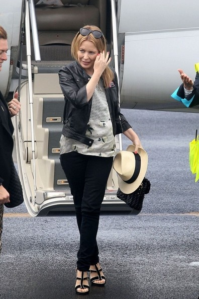 Kylie Minogue..not a fan but she knows how to dress for her height!!