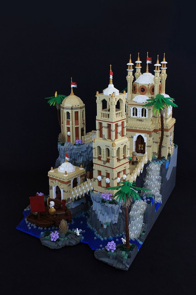 Built for the large miscellaneous category of the 14th Colossal Castle Contest. The scene was inspired by this image. It took about 2 weeks to build, and weighs 24.8 pounds, making it my largest solo build ever. Setting up the buildings layout and connecting them via bridges was the most challenging part, though the rockwork was most time consuming to build. Qasr Albahr is a large trade citadel in the Spice Islands of Kaliphlin. It serves as a hub of the trade between the islands and…