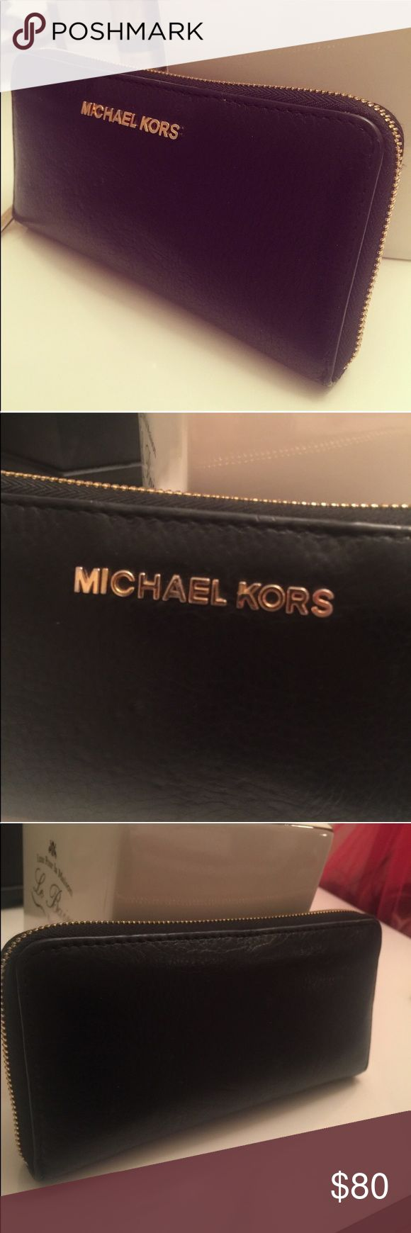 Michael Kors Wallet Like new! Black wallet with gold zipper. No damage at all. Michael Kors Bags Wallets