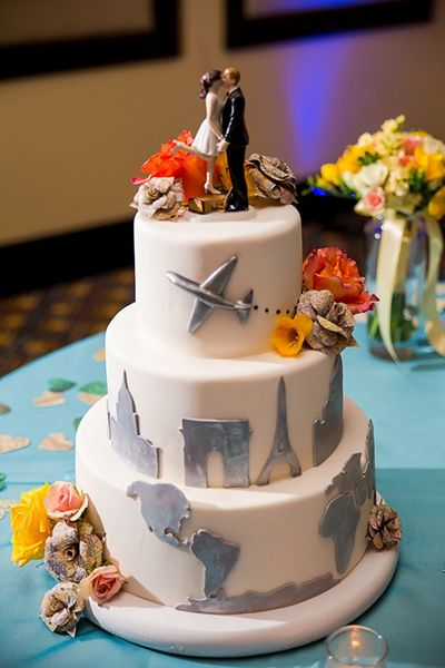 The groom, a pilot, honored his profession with a globetrotting cake; as a bonus, he included landmarks from the city where he proposed (Paris).