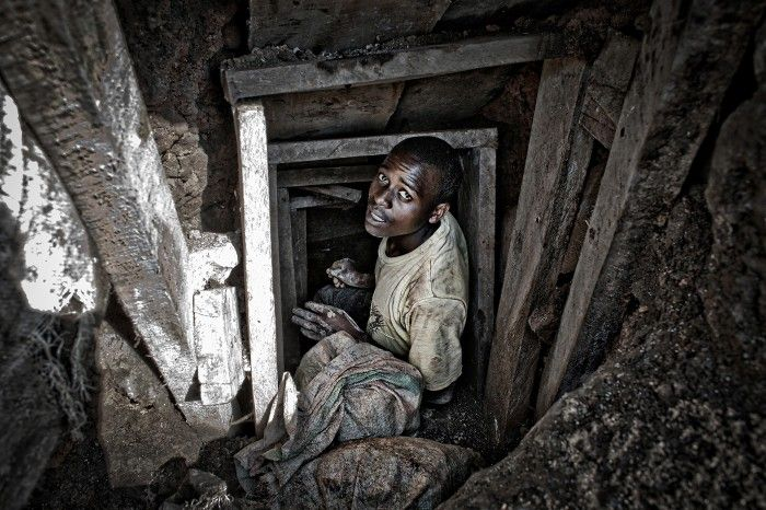 Rubaya, North Kivu, Masisi Region, D.R.Congo. Democratic Republic of Congo, North Kivu. A miner works inside a tunnel of the mine at Mudere: the minerals, coltan and manganite, are extracted by hand, using only using pickaxes and shovels. Every year hundreds people die inside these holes.