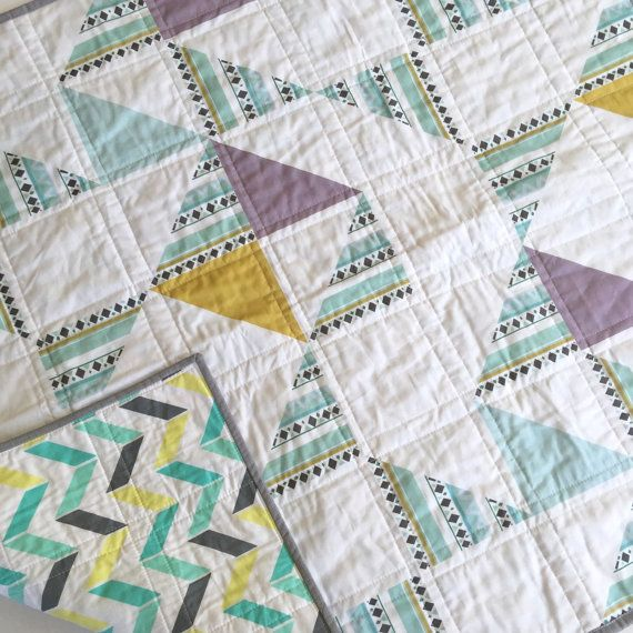 This modern geometric baby quilt blanket is sure to be a favorite, and I think youll find the gender neutral colors would be great for a boy or