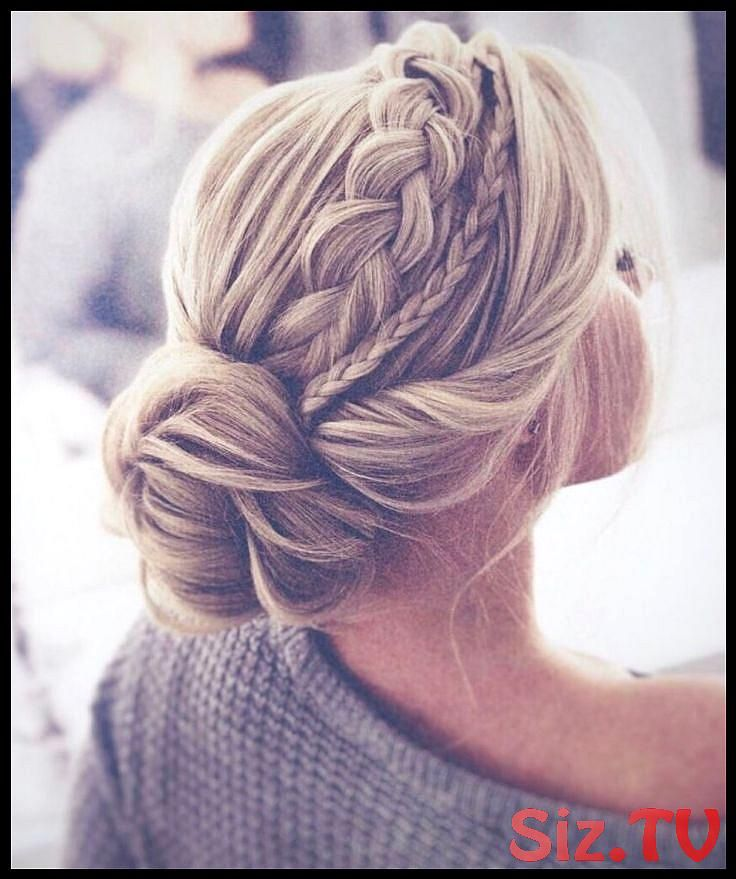The perfectly braided updo twisted into an elegant, cute bun. This hairstyle is the perfect braided updo …