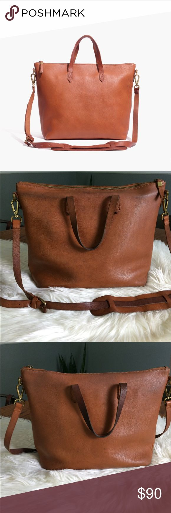 "Authentic Madewell Transport Satchel Well-loved with a lot of life left! Made of genuine vegetable tanned leather that burnishes with wear into a beautiful patina. As it is made of a natural material, each bag varies slightly in texture and color. Features two Top handles, zip closure, 1 interior zip pocket, 2 other interior pockets. 18 inch removable crossbody strap, 4 3/10"" handle drop. Measures 11 4/5"" H x 15 2/5"" W (at base) x 5 1/2 "" D. Perfect for work, travel or everyday. A quality…"
