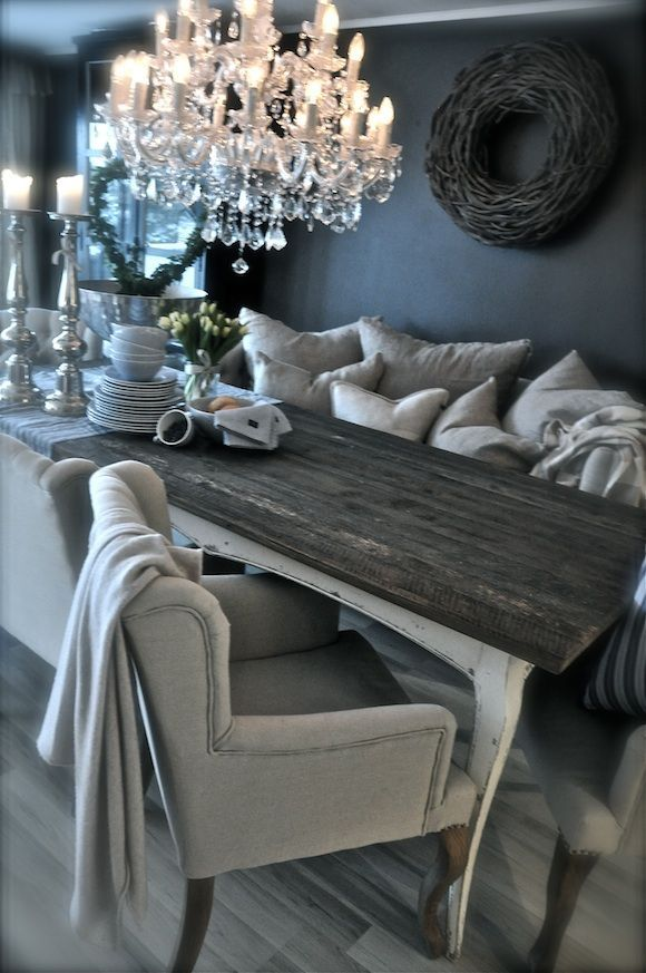 Love everything about this. Dark walls, neutrals, cozy furniture, rustic elements with a touch of glam. #Chandelier #Lighting #StandardProducts