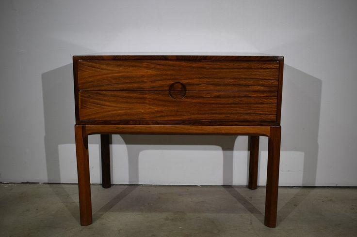 """Danish mid century rosewood dresser/ hallway unit with two drawers. By Aksel Kjersgaard. Rosewood veneer and solid rosewood legs. Branded """" Danish furnituremake"""