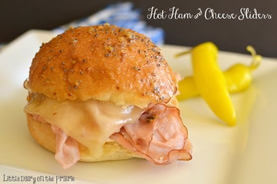 Hot Ham and Cheese Sliders with a mustard and poppy seed glaze!