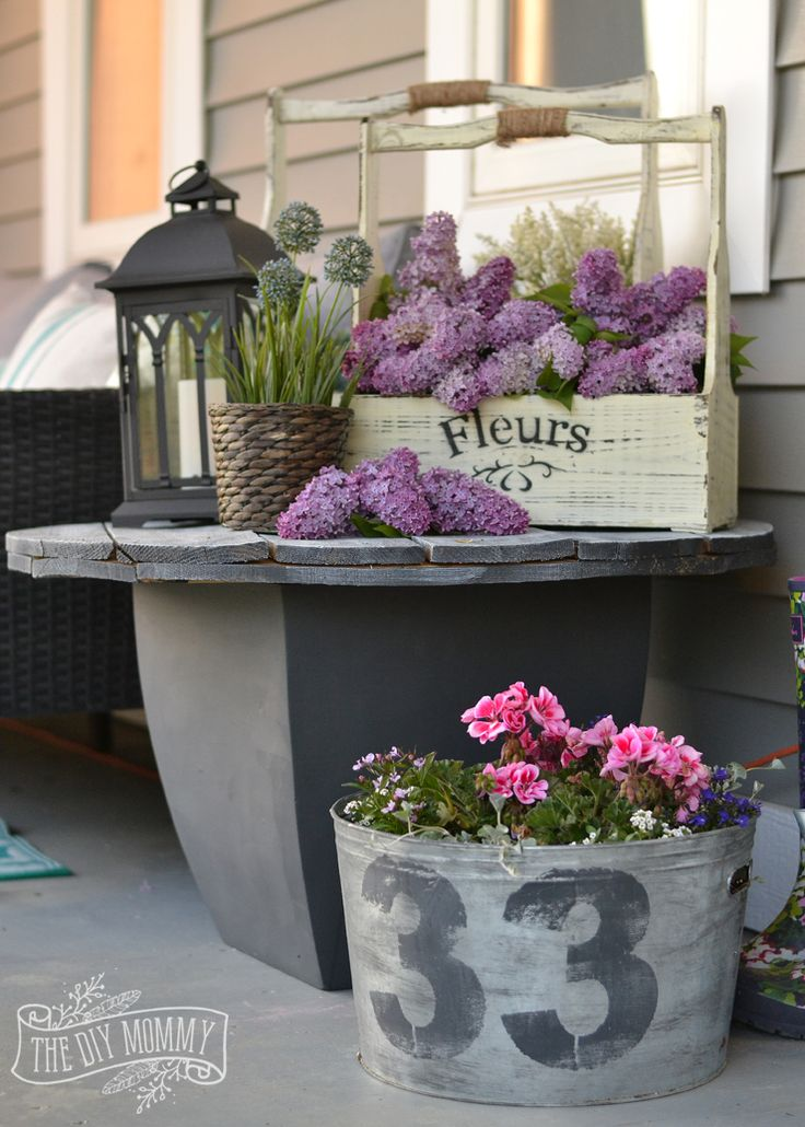 DIY outdoor side table from an electrical spool and an old planter