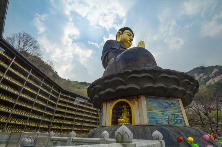 Visiting one of Korea's treasures at Bukhansan National Park. 북한산국립공원 (Bukhansan National Park) in 서울특별시 This golden buddha is surrounded by hundreds of smaller golden buddhas. Travel to Korea! See the rest of our photos and post here http://boboandchichi.com/2014/04/directions-golden-buddha/