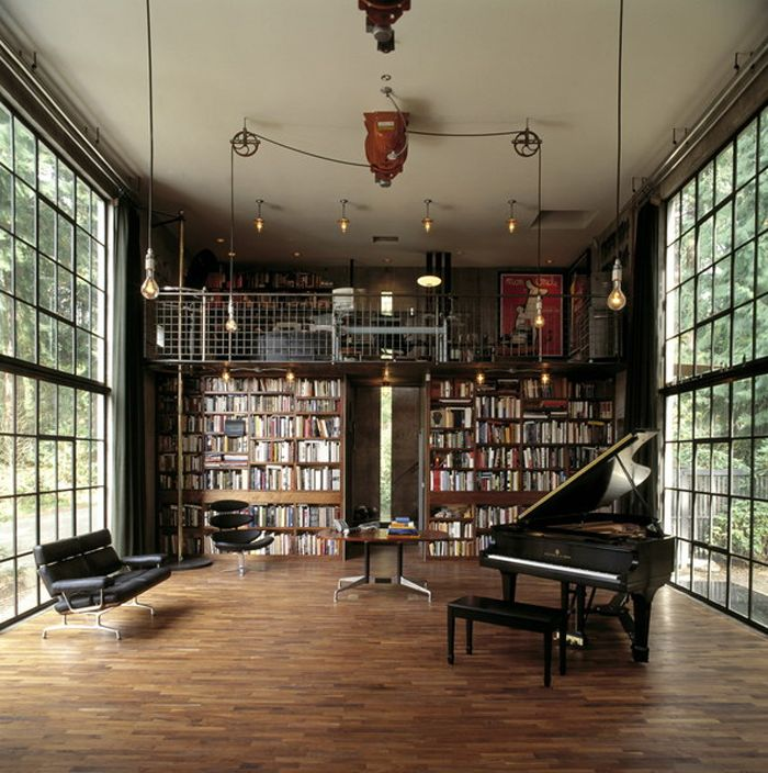 obsessed with this room. the windows, piano, tons of natural light, bookshelves, lighting, loft. amaze.