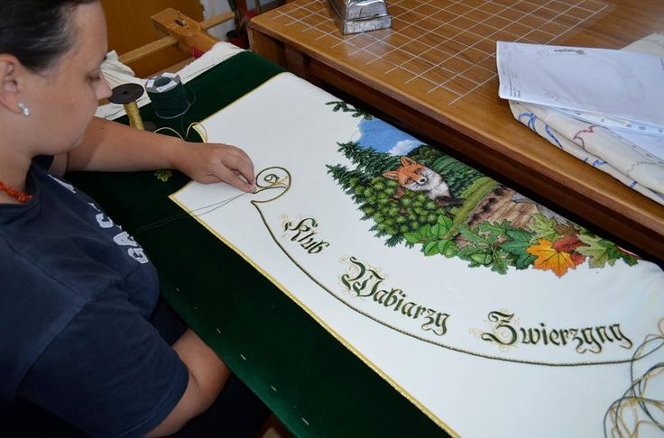 During a hand sewing a flag for gamekeepers.