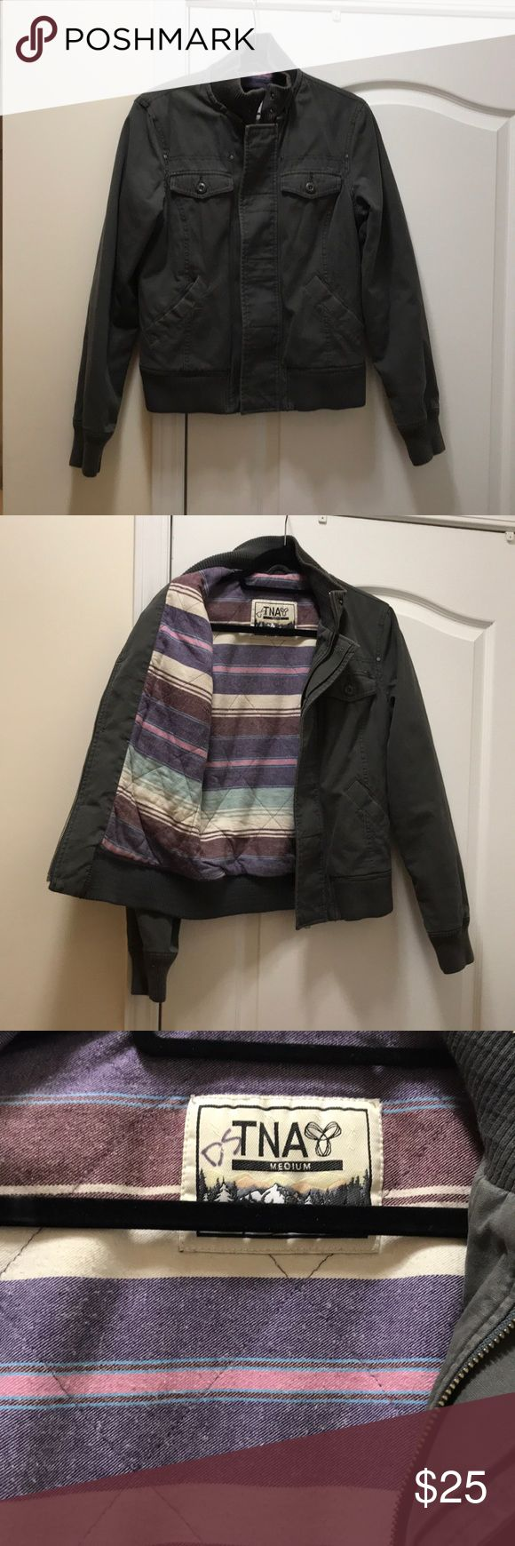 Grey Bomber Jacket size medium Grey bomber jacket TNA from Aritzia zipper and button front closure flannel lining inside. Super cute and easy to wear. Aritzia Jackets & Coats Utility Jackets