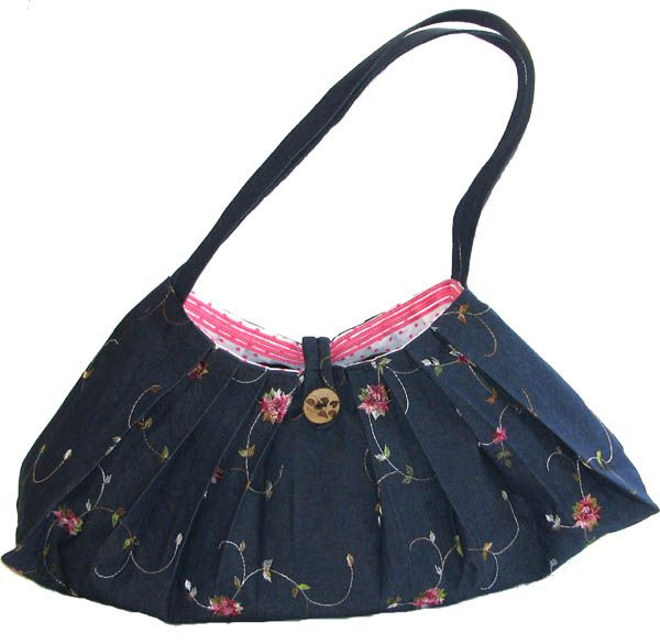 Denim Rose embroidery handbag AUD59.00 Its handmade of quality denim material with rose embroidery. Inside its fully lined with 100% cotton sewn in pink pokka dot material. The bag has got a intricate balinese style button to loop the bag. Inside there is a cellphone compartment and another pocket to keep your smaller items.   Dimensions: 27cm (top width) X 49cm (bottom width) X 21cm (tall from middle) X 10cm deep http://www.imusthavethat.com.au/pd-denim-embriodery-handbag.cfm