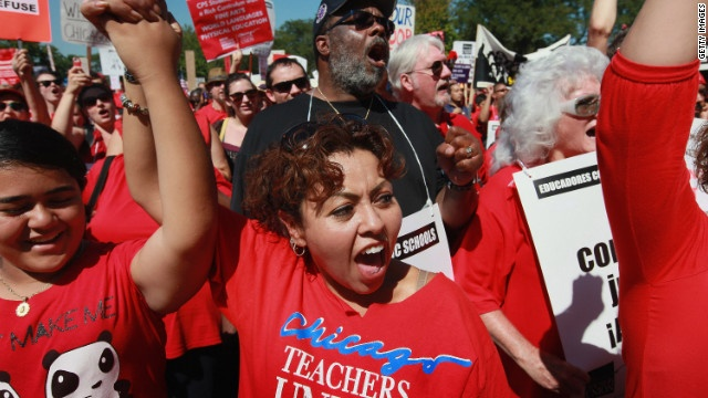 Striking teachers and their supporters attend a rally at Union Park on Saturday, September 15, in Chicago. An estimated 25,000 people gathered in the park in a show of solidarity. The week-old strike in Chicago's public schools will continue into the new week. Mayor Rahm Emanuel vows to go to court to force teachers back to work.