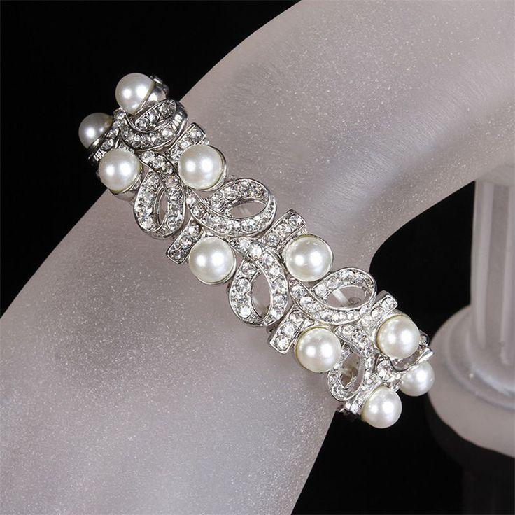 Prachtige armband met krullen van strass en parels