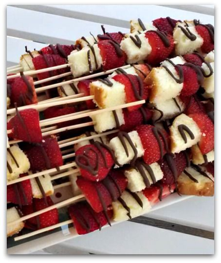 Ingredients:  1 to 2 pints of fresh strawberries  1 loaf of pound cake  wooden skewers  Directions:  Place your pound cake in the freezer for a few hours; it's easier to cut when frozen. Remove from freezer and cut into chunks. Rinse strawberries and slice in half. Assemble on skewers. Small bowls of chocolate sauce and whipped cream on the table for dipping.