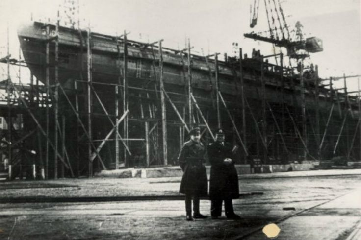 Year 1945 - Russian officers in Gdańsk Shipyard (Schichau Werft) with U-boot submarine in background.