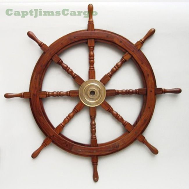 """CaptJimsCargo - Large 36"""" Teak Wooden Ships Steering Wheel Solid Brass Center, (http://www.captjimscargo.com/nautical-home-decor/ship-steering-wheels/large-36-teak-wooden-ships-steering-wheel-solid-brass-center/) There is not a better way to enhance your nautical marine decor than with a rugged wooden ship steering wheel inside or outside (this teak ships wheel can weather the elements)."""