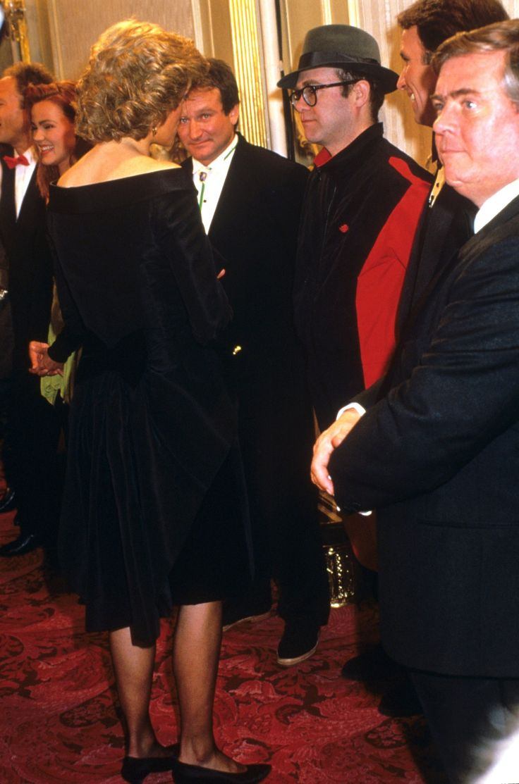 Robin Williams looks over at Princess Diana during the Prince's Trust Charity in London, 1987.