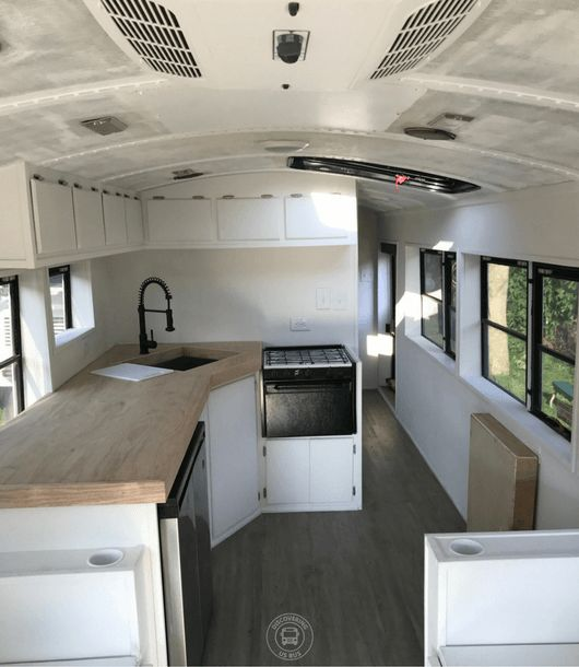 A converted school bus does not have to have a center isle. Check out this floor plan at discoveringusbus.com