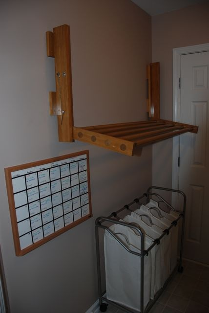 I showed my husband a 250.00 dollar fold down drying rack that I really wanted and here is his version that only cost $40 to make.  Now I cannot wait for those things that say lay flat to dry.