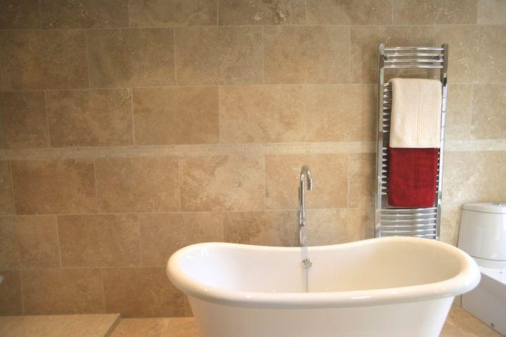Travertine Tile bath. triangle tiles