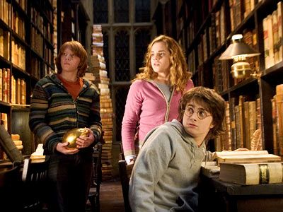 The Harry Potter films mostly take place in the fictional Hogwarts School of Witchcraft and Wizardry, which has a great old Library. The library scenes are filmed in a real library: Duke Humfrey's Library at the Bodleian Library at Oxford in England