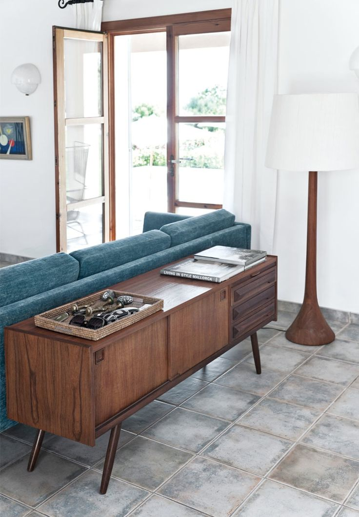 We love this retro but elegant sideboard in teak wood used for storage in the living room.